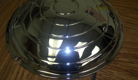 Cadillac hubcap after restoration